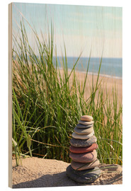 Trebilde  A tower of stones on a dune at the sea - Buellom