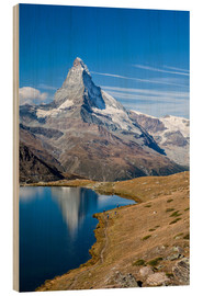 Trebilde  Hikers walking on the path beside the Stellisee with the Matterhorn reflected. Zermatt Canton of Val - Roberto Sysa Moiola