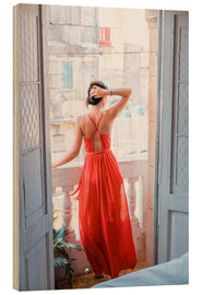 Trebilde  Young attractive woman in red dress